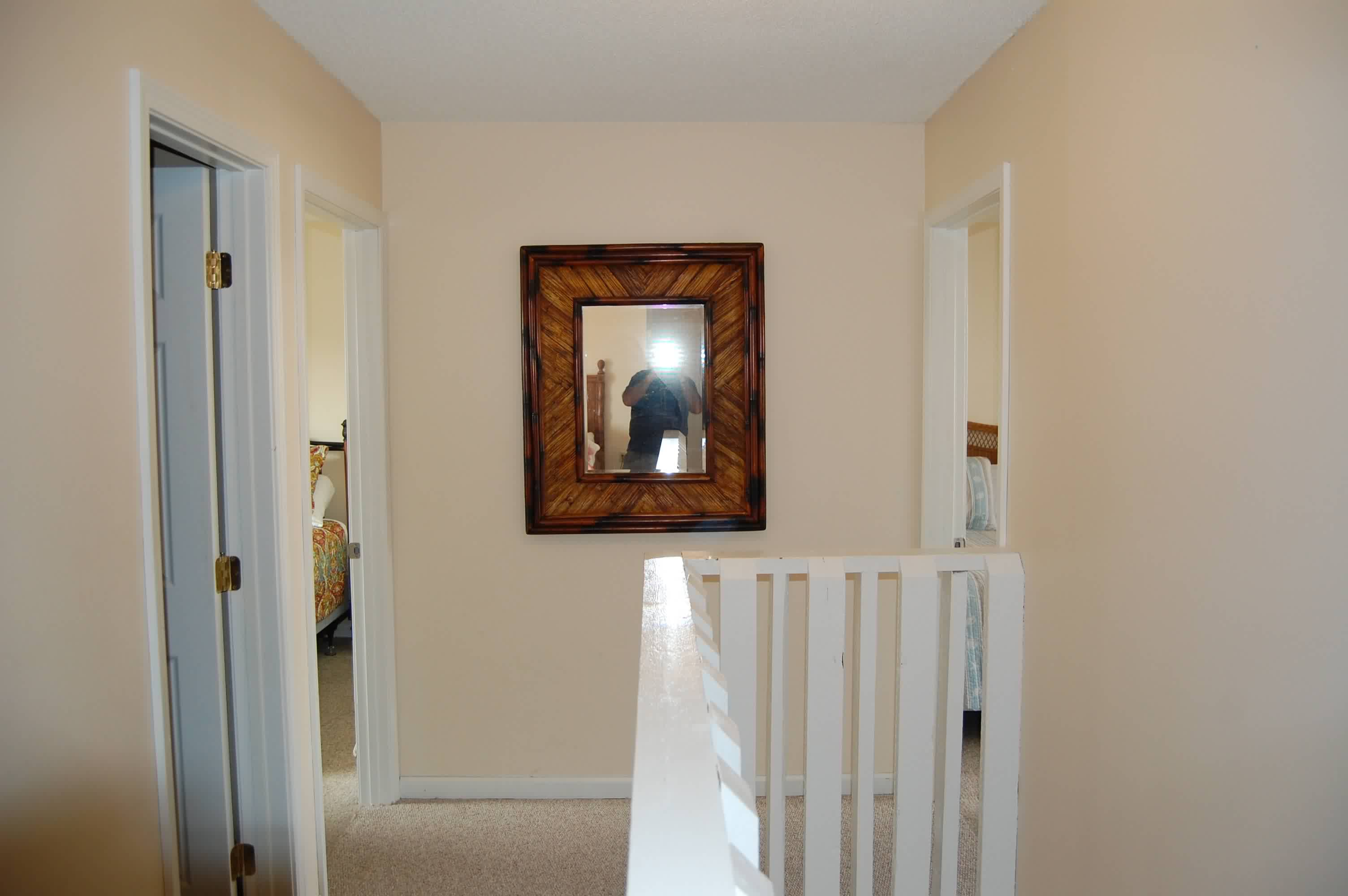 Upstairs hall view of 2nd and 3rd bedroom